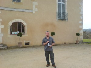 me outside Chateau Corbiac clutching a bottle of the 2004 red